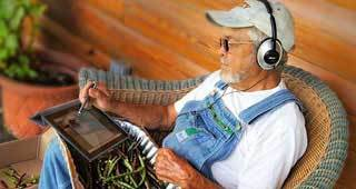 man listening to an ipad with headphones