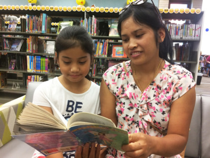 "Southport Branch patron Hram Iang reads to her 8-year-old Esther during The Indianapolis Public Library's 2019 Summer Reading Program, ""Keepin' it 100,"" which continues through July 27."